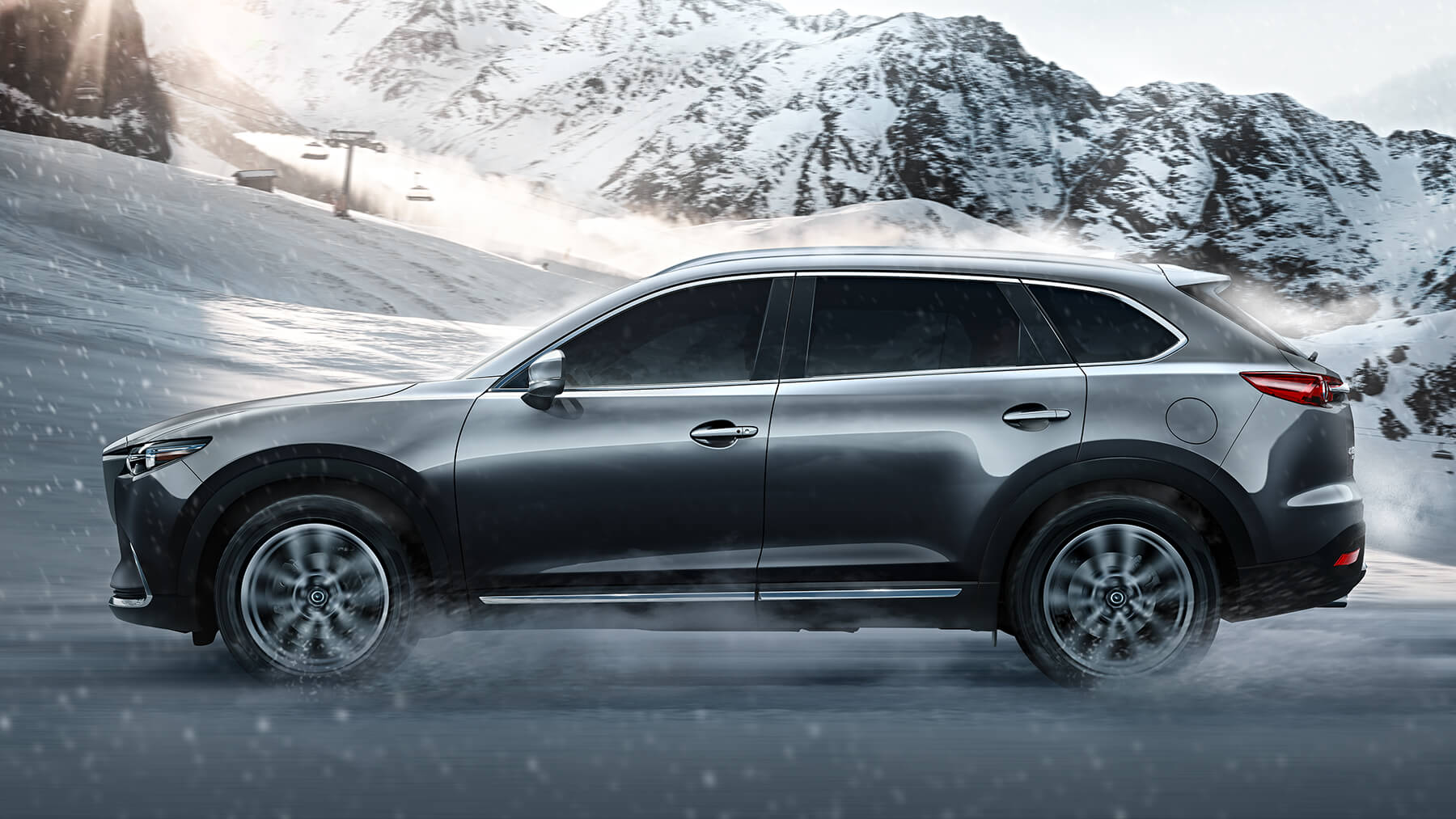 2016-cx9-machine-grey-driving-snow-mde-cx9-gallery