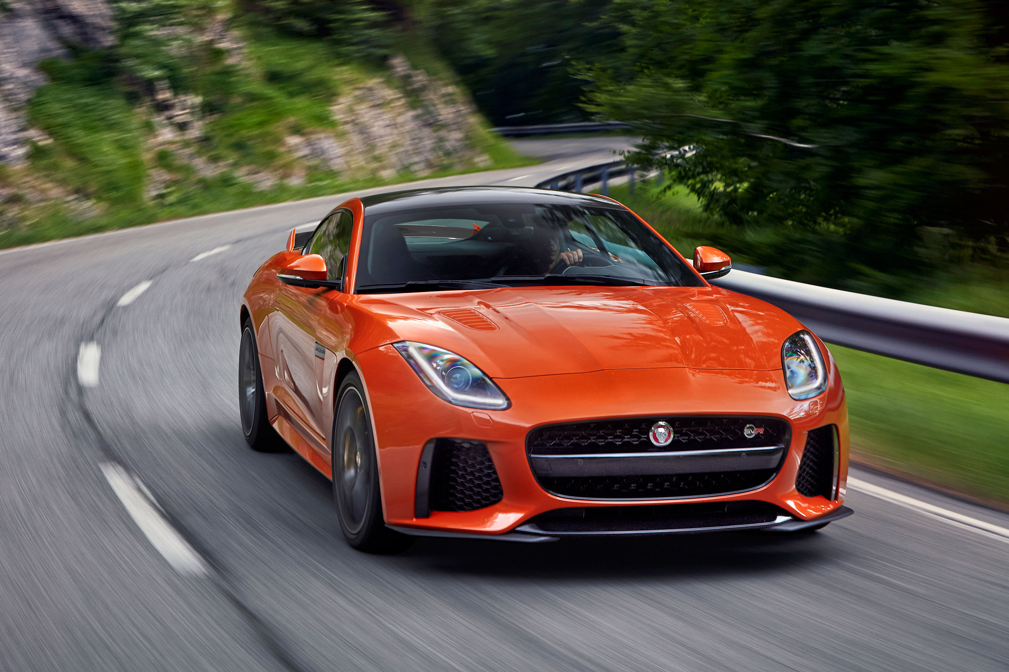 2017-jaguar-f-type-svr-front-three-quarter-in-motion-07