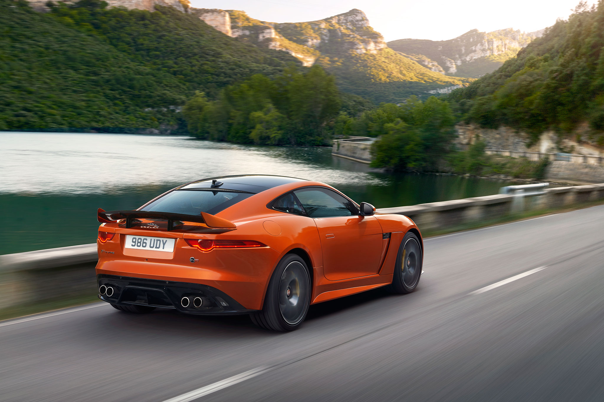 2017-jaguar-f-type-svr-rear-three-quarter-in-motion-01