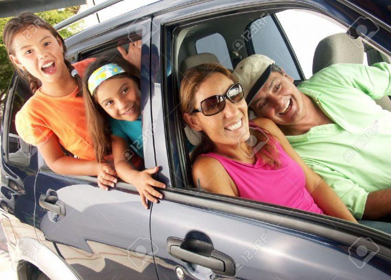 hispanic-family-sitting-in-a-car