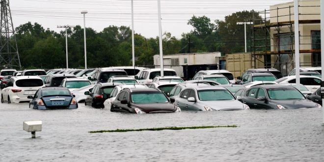 A car dealership is covered by Hurricane Harvey floodwaters near Houston