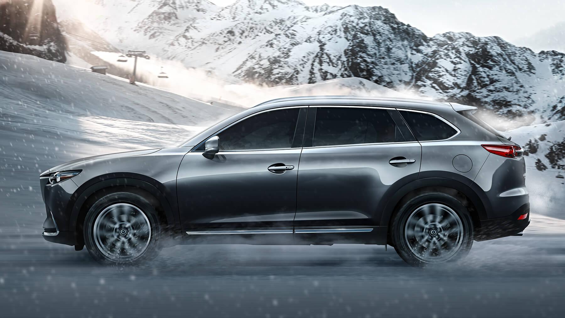 2016-cx9-machine-grey-driving-snow-mde-cx9-gallery