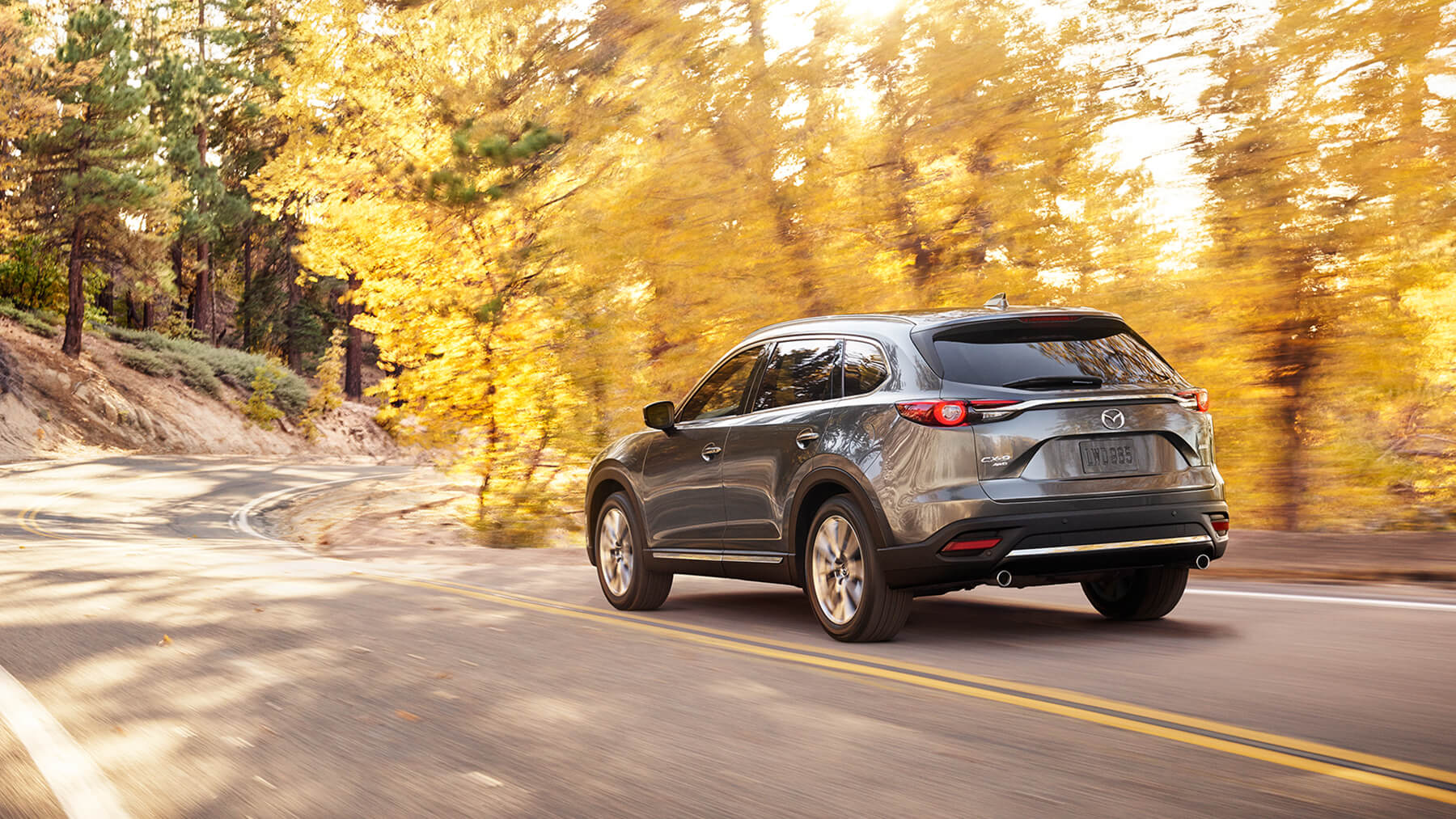 2016-cx9-machine-grey-driving-woods-mde-cx9-gallery